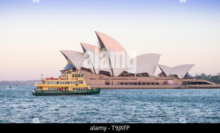 SYDNEY, AUSTRALIA - FEBRUARY 11, 2019: A ferry passing Sydney Opera House, Australia's most recognisable building and a UNESCO World Heritage Site. - Stock Photo