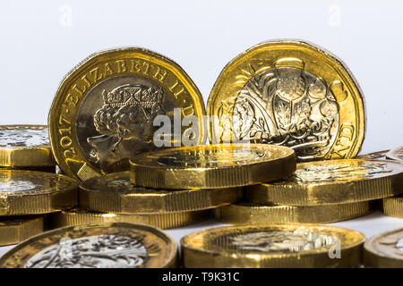 Pound coins in a pile. - Stock Photo