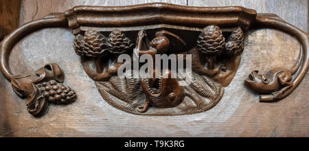 A medieval misericord depicting Jonah being cast ashore on Nineveh, Ripon Cathedral, Yorkshire, UK - Stock Photo