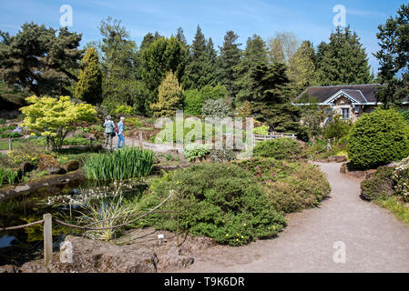 Rock Garden and Caledonia Hall in the Royal Botanic Garden Edinburgh (RBGE), Scotland, UK. - Stock Photo