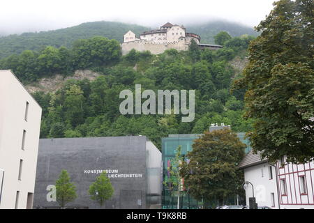 View of the Kunstmuseum building, a modern art museum and the Castle Vaduz, Principality of Liechtenstein - Stock Photo