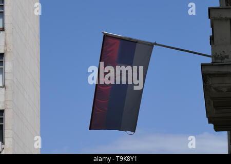 Serbian flag in the capital Belgrade - Stock Photo