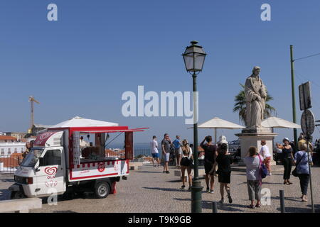 PORTUGAL, LISBON - SEPTEMBER 30, 2018: Some people around the Statue of San Vicente, patron saint of Lisbon, Portugal - Stock Photo