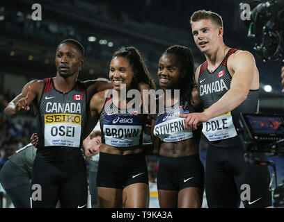 YOKOHAMA, JAPAN - MAY 10: Philip Osei, Alicia Brown, Aiyanna Stiverne and Austin Cole of Canada after the mixed 4x400m relay during Day 1 of the 2019 IAAF World Relay Championships at the Nissan Stadium on Saturday May 11, 2019 in Yokohama, Japan. (Photo by Roger Sedres for the IAAF) - Stock Photo
