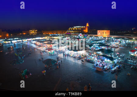 Marrakech, Morocco - May 11 2019: Jema Eel-fna Square seen at night, full of life and activities, tourists, merchants, restaurants, stalls. - Stock Photo