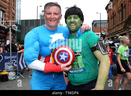 Runners in fancy dress after completing the Simply Health Manchester Run. - Stock Photo