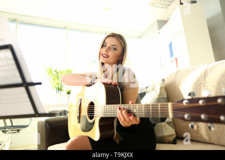 Beautiful Guitarist Creating Musical Composition - Stock Photo