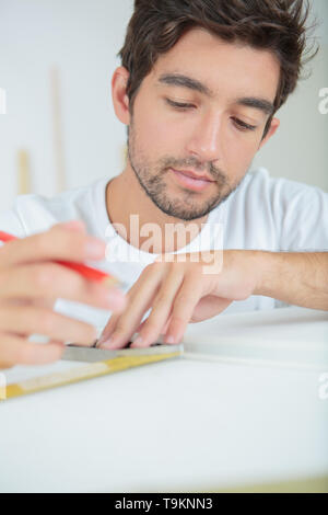 man draws design - Stock Photo