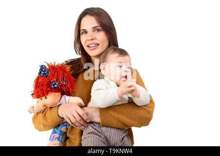 Loving mother and her baby girl with the toy isolated on white background - Stock Photo