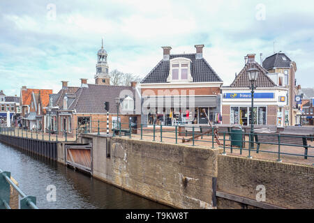 NETHERLANDS - LEMMER - MARCH 8, 2019: Sluice and buildings in the center of Lemmer in in Friesland, Netherlands. - Stock Photo