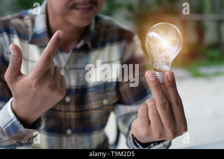 A hand holding is light bulb, Creative ideas concept, lightbulb for new idea, object design for thinking - Image - Image