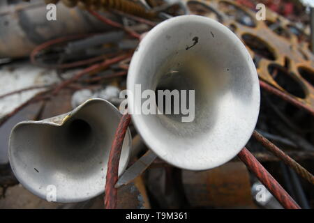 Scrap metal recycling, semi truck horns in a pile of discarded materials for recycling in the USA. - Stock Photo