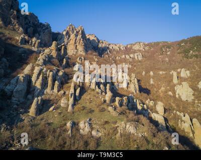 Demerdzhi mountain range in the rays of the setting sun. Autonomous Republic of Crimea Демерджи Долина привидений Алушта Крым Россия и Украина мир - Stock Photo