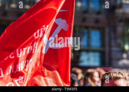 Immortal regiment - people carry comunist flag, Victory Day, Nevsky Prospect, St. Petersburg, Russia - Stock Photo