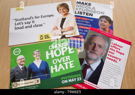European Elections 2019 leaflets from SNP, Scottish Labour, Scottish Green Party, Scottish Labour and Scottish Conservative parties. - Stock Photo