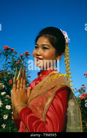 Thailand. Bangkok. Outdoors portrait of young woman finger dancer in traditional dress. - Stock Photo
