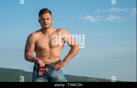 Athletic training. Athletic man with muscular torso on blue sky. Sportsman with athletic equipment outdoor. Athletic lifestyle and sport. Make - Stock Photo