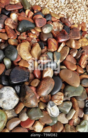 Jade pebbles or ziliao and other minerals. Hetian or Hotan jade is nephrite consisting mainly of tremolite with up to 5% impurities coloring it white- - Stock Photo