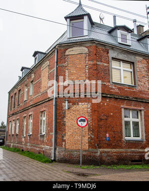 GDANSK ,POLAND; 17th MAY 2019: A rundown red-brick housing block. This neighbourhood is just outside the city centre. - Stock Photo