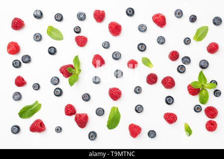 Fresh summer berries flat lay. Blueberries, raspberries and mint leaf pattern. Top view - Stock Photo