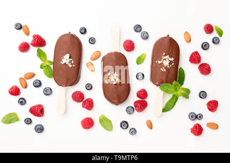 Chocolate ice cream pops and berries flat lay on white background. Table top view. Summer concept - Stock Photo