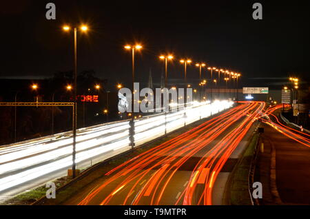 Cologne city highway at night, traffic light trails - Stock Photo