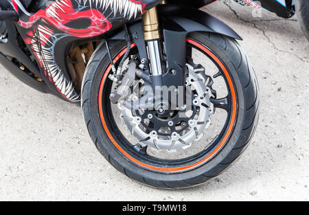 Samara, Russia - May 18, 2019: Front wheel of sports motorcycle. Brake system of a motorbike - Stock Photo