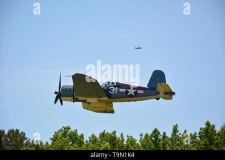 A Corsair during takeoff in the 2019 Virginia Beach Military Aviation Museum WWII show. - Stock Photo