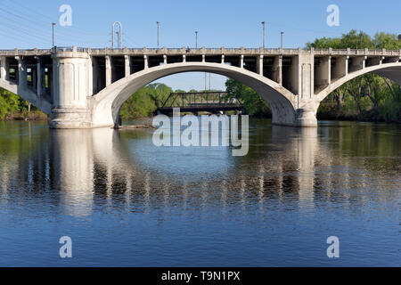 Detail of the Third Avenue Bridge spanning the Mississippi River in downtown Minneapolis, Minnesota.  The bridge was designed by Frederick W. Cappelen. - Stock Photo