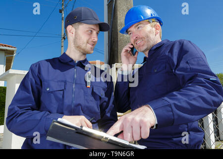 electrician with line post on the background - Stock Photo
