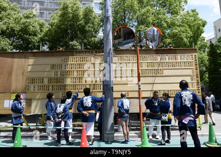 TOKYO, JAPAN - MAY 18: Participants look at the messages board announcing donation details during 'Sanja Matsuri' on May 18, 2019 in Tokyo, Japan. A boisterous traditional mikoshi (portable shrine) is carried in the streets of Asakusa to bring good luck, blessings and prosperity to the area and its inhabitants. (Photo: Richard Atrero de Guzman/ AFLO) - Stock Photo