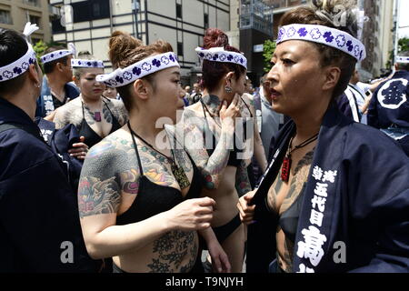 TOKYO, JAPAN - MAY 18: Heavily tattooed Japanese women walk in the street of Asakusa during 'Sanja Matsuri' on May 18, 2019 in Tokyo, Japan. A boisterous traditional mikoshi (portable shrine) is carried in the streets of Asakusa to bring goodluck, blessings and prosperity to the area and its inhabitants. (Photo: Richard Atrero de Guzman/ AFLO) - Stock Photo