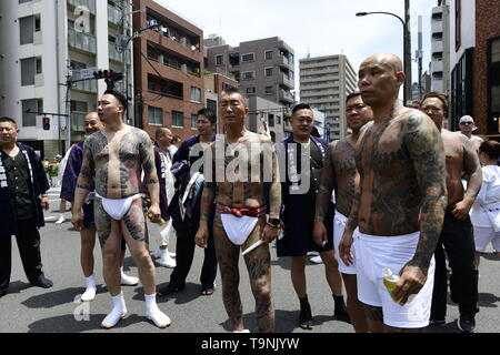 TOKYO, JAPAN - MAY 18: Heavily tattooed Japanese men wait for miyoshi n the street of Asakusa during 'Sanja Matsuri' on May 18, 2019 in Tokyo, Japan. A boisterous traditional mikoshi (portable shrine) is carried in the streets of Asakusa to bring goodluck, blessings and prosperity to the area and its inhabitants. (Photo: Richard Atrero de Guzman/ AFLO) - Stock Photo