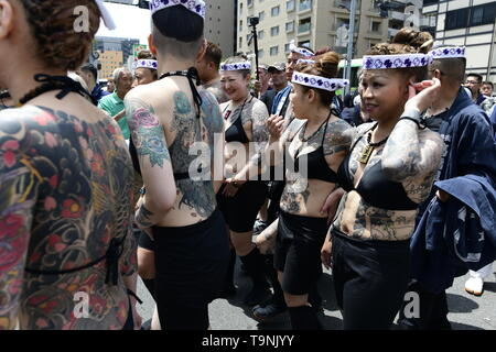 TOKYO, JAPAN - MAY 18: Heavily tattooed Japanese women chat in the street of Asakusa during 'Sanja Matsuri' on May 18, 2019 in Tokyo, Japan. A boisterous traditional mikoshi (portable shrine) is carried in the streets of Asakusa to bring goodluck, blessings and prosperity to the area and its inhabitants. (Photo: Richard Atrero de Guzman/ AFLO) - Stock Photo