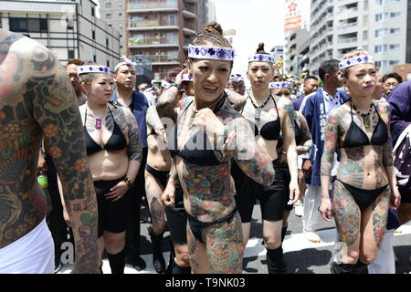 TOKYO, JAPAN - MAY 18: Heavily tattooed Japanese men and women walk in the street of Asakusa during 'Sanja Matsuri' on May 18, 2019 in Tokyo, Japan. A boisterous traditional mikoshi (portable shrine) is carried in the streets of Asakusa to bring goodluck, blessings and prosperity to the area and its inhabitants. (Photo: Richard Atrero de Guzman/ AFLO) - Stock Photo