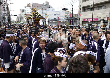 TOKYO, JAPAN - MAY 18: Participants clad in traditional happi coats carry a portable shrine as they parade in the streets of Asakusa during Tokyo's one of the largest three day festival called 'Sanja Matsuri' on May 18, 2019 in Tokyo, Japan. A boisterous traditional mikoshi (portable shrine) is carried in the streets of Asakusa to bring good luck, blessings and prosperity to the area and its inhabitants. (Photo: Richard Atrero de Guzman/ AFLO) - Stock Photo