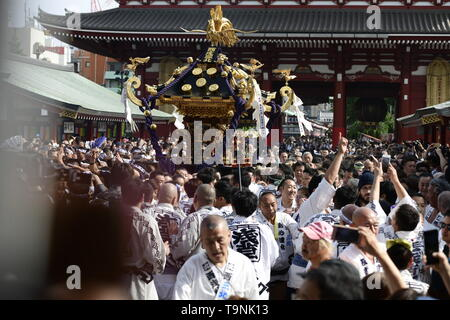 TOKYO, JAPAN - MAY 18: Participants clad in traditional happi coats carry a portable shrine in front of Sensoji Temple during Tokyo's one of the largest three day festival called 'Sanja Matsuri' on May 18, 2019 in Tokyo, Japan. A boisterous traditional mikoshi (portable shrine) is carried in the streets of Asakusa to bring goodluck, blessings and prosperity to the area and its inhabitants. (Photo: Richard Atrero de Guzman/ AFLO) - Stock Photo