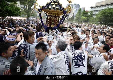 TOKYO, JAPAN - MAY 18: Participants clad in traditional happi coats carry a portable shrine near Sensoji Temple during Tokyo's one of the largest three day festival called 'Sanja Matsuri' on May 18, 2019 in Tokyo, Japan. A boisterous traditional mikoshi (portable shrine) is carried in the streets of Asakusa to bring goodluck, blessings and prosperity to the area and its inhabitants. (Photo: Richard Atrero de Guzman/ AFLO) - Stock Photo