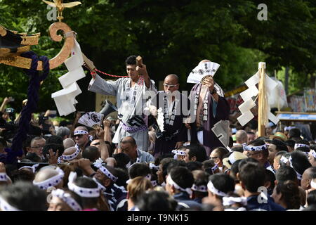 TOKYO, JAPAN - MAY 18: Participants claps with wooden blocks in front of the portable shrine during Tokyo's one of the largest three day festival called 'Sanja Matsuri' on May 18, 2019 in Tokyo, Japan. A boisterous traditional mikoshi (portable shrine) is carried in the streets of Asakusa to bring luck, blessings and prosperity to the area and its inhabitants. (Photo: Richard Atrero de Guzman/ AFLO) - Stock Photo