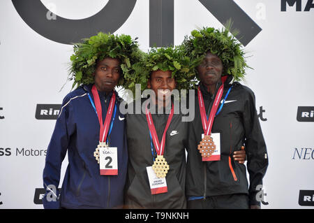 Riga, Silas Kiprono and Julius Tuwei of Kenya pose at the medal ceremony for the Tet Riga Marathon 2019 in Riga of Latvia. 19th May, 2019. Andulaem Belay Shiferaw (C) of Ethiopia, Silas Kiprono and Julius Tuwei of Kenya pose at the medal ceremony for the Tet Riga Marathon 2019 in Riga of Latvia, on May 19, 2019. Credit: Janis/Xinhua/Alamy Live News - Stock Photo