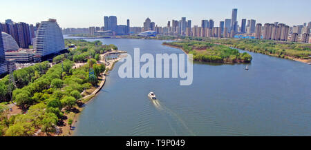 (190520) -- BEIJING, May 20, 2019 (Xinhua) -- Aerial photo taken on May 1, 2019 shows a scenery of the Hunhe River which flows through the city of Shenyang, northeast China's Liaoning Province. Liaoning Province is located in the southern part of Northeast China, with the Bohai Sea and the Yellow Sea lying to its south. Over the years, the provincial government has prioritized ecological development and set environmental improvement at the core of its agenda. The province's ecological conditions have been improving thanks to systematic conservation of the natural environment, overall managemen - Stock Photo
