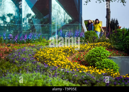 (190520) -- BEIJING, May 20, 2019 (Xinhua) -- Visitors tour the Liaoning Garden of the Beijing International Horticultural Exhibition in Beijing, capital of China, April 29, 2019. Liaoning Province is located in the southern part of Northeast China, with the Bohai Sea and the Yellow Sea lying to its south. Over the years, the provincial government has prioritized ecological development and set environmental improvement at the core of its agenda. The province's ecological conditions have been improving thanks to systematic conservation of the natural environment, overall management of the rural - Stock Photo