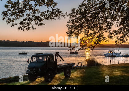 Courtmacsherry, Cork, Ireland. 20th May, 2019. A  classic 1960's Mercedes Unimog 404 flatbed truck parked near the waters edge in Courtmacsherry, Co. Cork, Ireland. Credit; David Creedon / Alamy Live News - Stock Photo