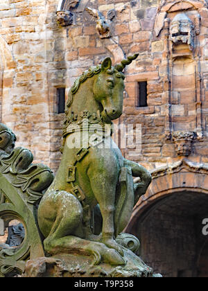 LINLITHGOW, SCOTLAND - SEPTEMBER 2016:  The central courtyard of Linlithgow Palace contains an ornate fountain with numerous statutes of mythical crea - Stock Photo