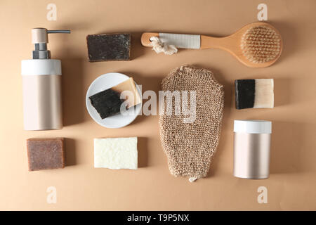 Soap and bathing accessories on wooden background - Stock Photo