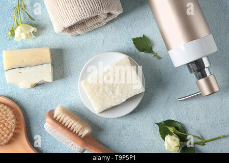 Soap and bathing accessories on table - Stock Photo