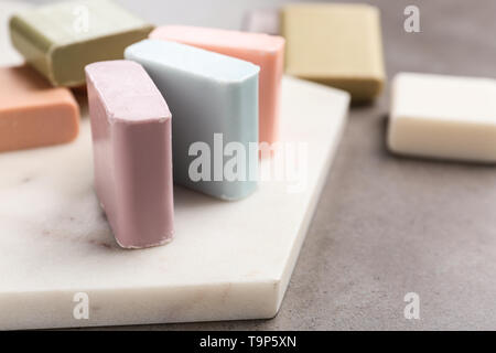 Different soap bars on table - Stock Photo