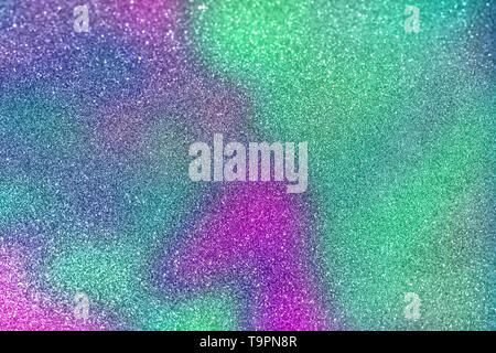 Abstract blurred of green and purple glittering shine bulbs lights background blur of Christmas wallpaper decorations concept. holiday festival backdr - Stock Photo
