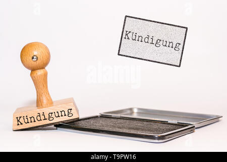 Rubber stamp on white background with the german word for 'termination' - Stock Photo