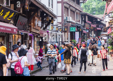 Tourists are walk for shopping in Ciqikou ancient town, a popular travel destination on Chongqing, China. - Stock Photo